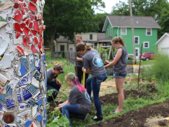 FFA students from Hartford, Brillion, Merrill and Bay Port work in the community garden at Goodman Community Center during Day of Service on June 11, 2018.