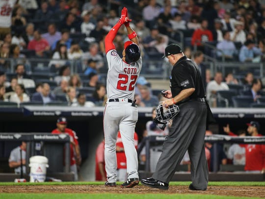 Washington Nationals left fielder Juan Soto (22) celebrates at home plate after hitting a home run in the seventh inning against the New York Yankees at Yankee Stadium.