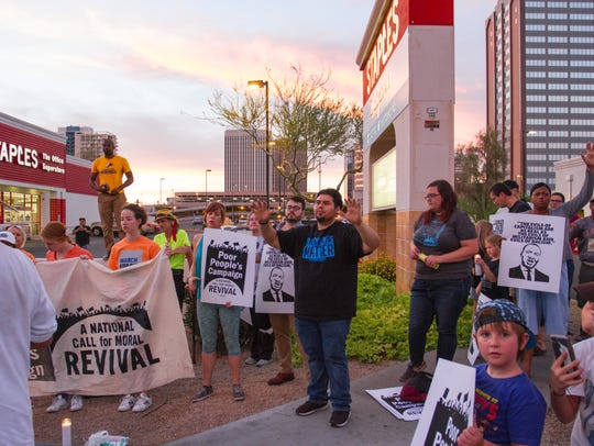 Dozens of protesters gathered in Phoenix on June 12,