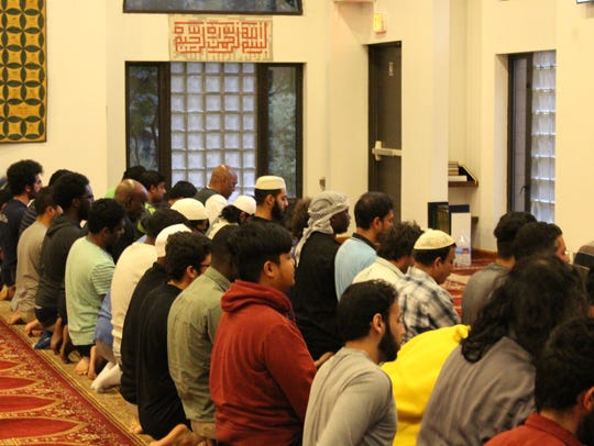 Members of the Islamic Center of Rochester pray Tuesday