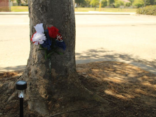 A makeshift memorial sits at Salinas' El Dorado Park for Ernesto Garcia Cruz, 27. Cruz was fatally shot at the park June 5. Salinas police later arrested Santos Longoria Fonseca, 19, and Alexandra Catherine Romayor, 18, on suspicion of killing Cruz, who did not have any known gang ties, officers have said.