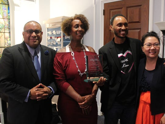 Left to right: Co-parenting advocate and attorney Scott Bolden, Sunshine Muse, who won the first annual co-parenting award with ex-husband Yohance Maqubela, Frank Love, who co-sponsored the award, and HyeSook Chung, Washington's deputy mayor for health and human services.