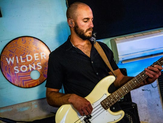 Bassist Dan Springs plays during a Wilder Sons rehearsal