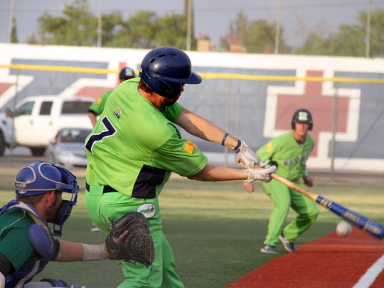 Roswell slugger Ben McCandles (7) puts the ball in