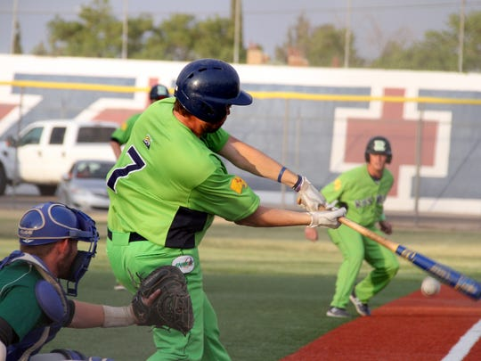 Roswell slugger Ben McCandles (7) puts the ball in play with a runner coming down the line at third.