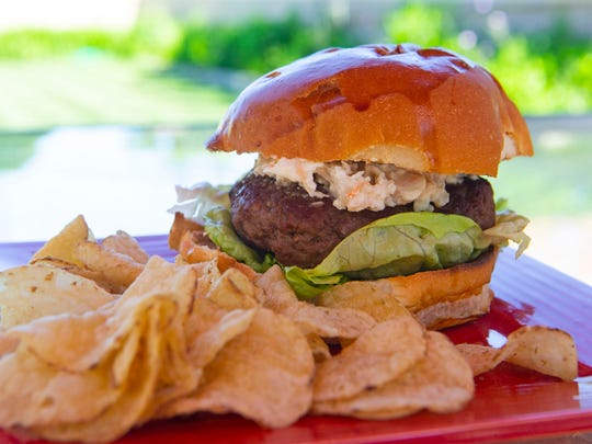 Brioche buns enclose the Biloxi Butter Burger, with its shrimp spread topping.