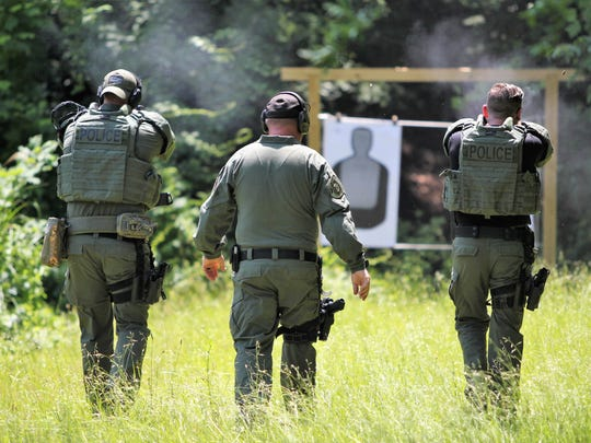 Officers with Black Mountain's Special Response Team perform training exercises at the department's range on June 7. Members of the team are required to hit targets with 95 percent accuracy.