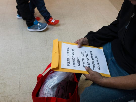 A man browses through a packet he was given after being released by U.S. Immigration officials on Thursday, May 7, 2018, at the Catholic Charities Rio Grande Valley refugee center in McAllen, Texas.