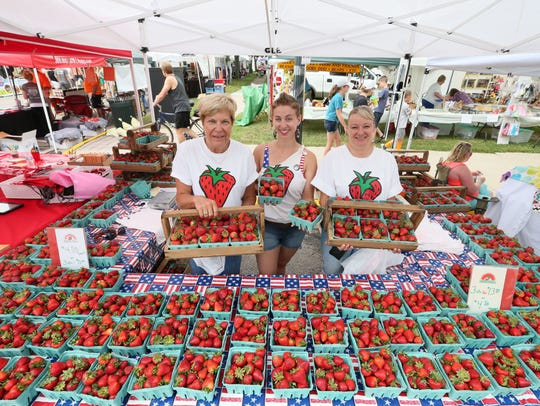 Berry sellers including Cheryl Schmit (from left),