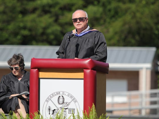 Tim Raines delivers the commencement address to the Owen High School class of 2018 in June. Raines, who was appointed to the board of aldermen on Aug. 9, taught at the school for over 20 years.