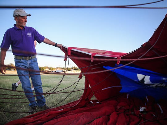 Pilot Joe Heartsill fills his balloon with air hoping the wind dies down enough to fly during the San Angelo Lions Balloonfest Friday, June 15, 2018, at John Glenn Middle School football field.