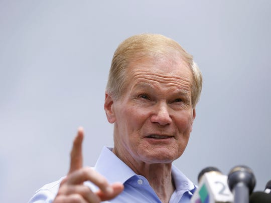 U.S. Sen. Bill Nelson talks to the media during a news