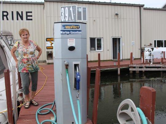 Sandy Habecker, part owner of Krenzer Marine, shows a gas pump that was underwater last summer.