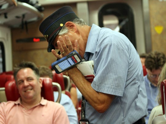 "While punching tickets on Monday's train, Diomede said ""Wait, I owe this guy a little something"" and broke out his harmonica for the passenger on the left."