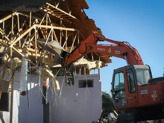 Workers demolish the Victory Christian Center in San