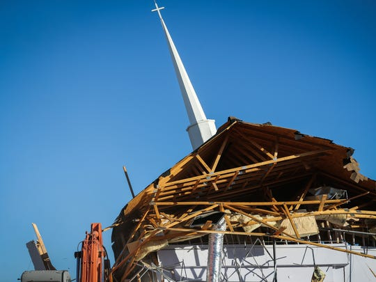 The steeple falls as workers demolish the Victory Christian