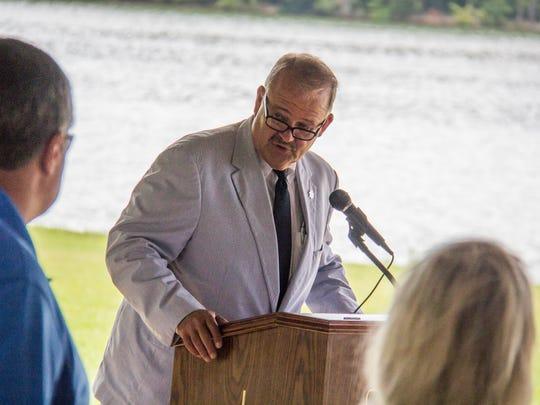 Lenoir City Mayor Tony Aikens announces a plan for kayak and paddleboard rentals at Lenoir City Park on Thursday.