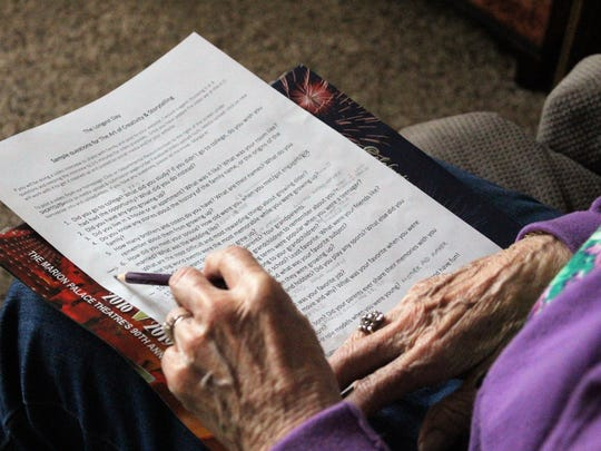 Phyllis Peters looks at a list of questions as she prepares to record some of her memories on Thursday.