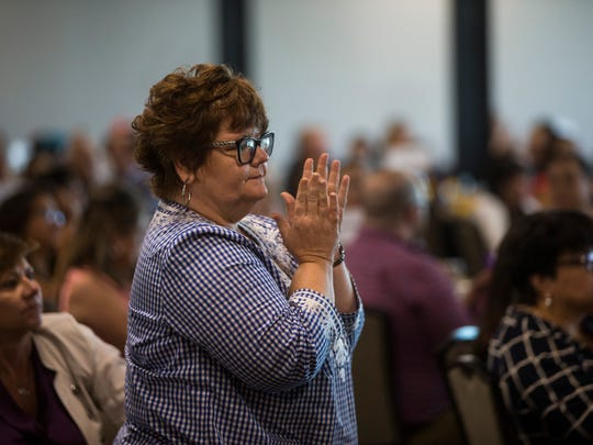 Waynette Jarrell, from VAP Business Solutions, claps following a speech during 7th Annual Great Expectations Luncheon that benefits The Purple Door on Tuesday, June 26, 2018, at the Congressman Solomon P. International Center.