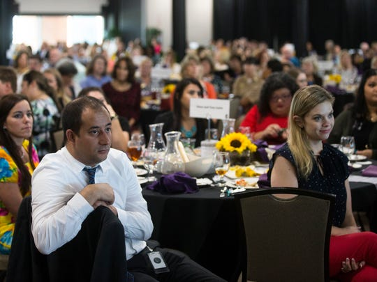 Prosecutor's of the Domestic Violence Bureau Hadee Khan (left) and Erica Matlock listen to speech during 7th Annual Great Expectations Luncheon that benefits The Purple Door on Tuesday, June 26, 2018, at the Congressman Solomon P. International Center.