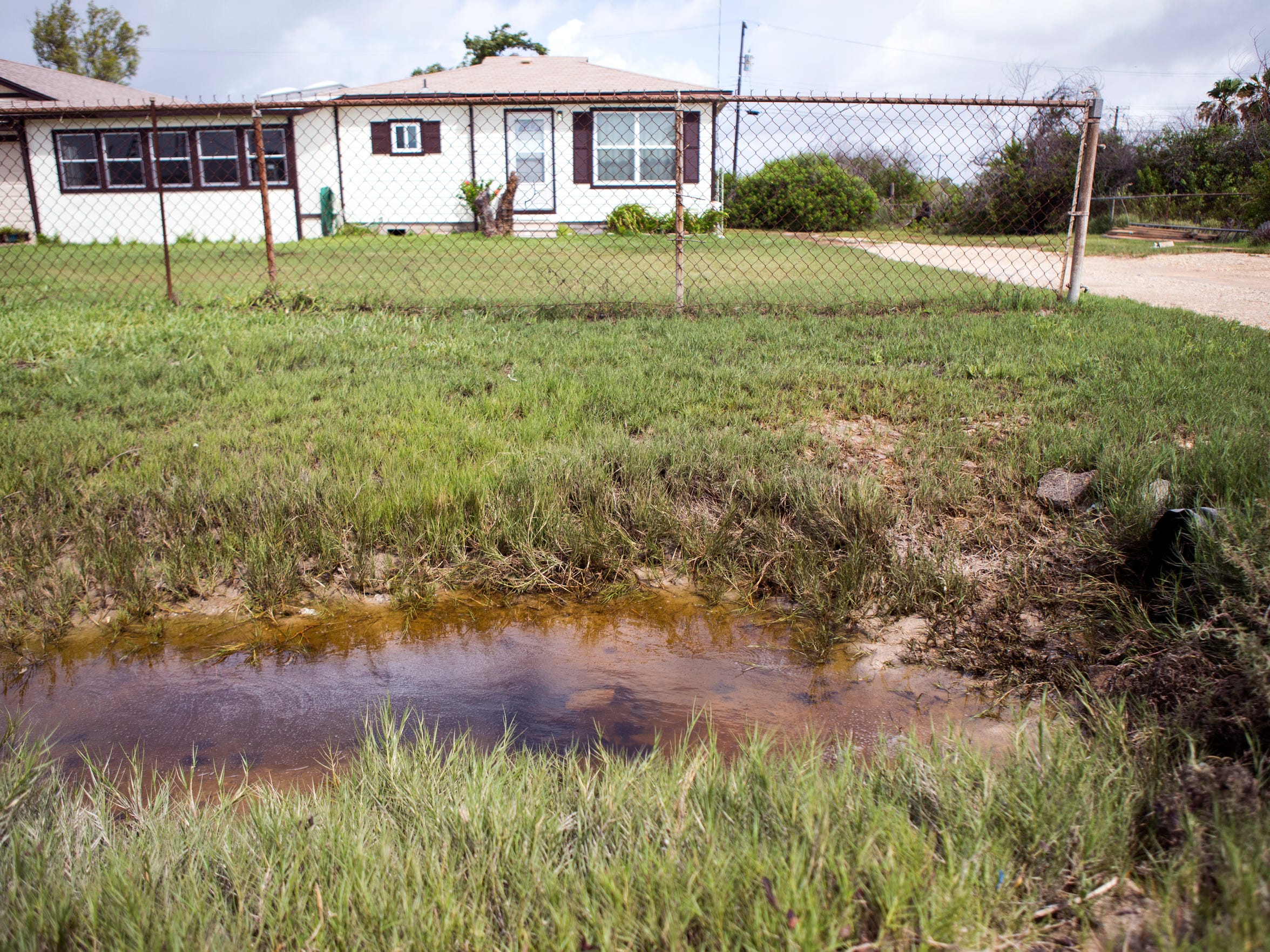 Hope Comingore is a long-time resident of Aransas Pass who lives just above the seawall. She has flooded repeatedly over the several years she has lived in her home, she said Monday, June 25, 2018. She said that the water from all of downtown and the flats runs across her property as it is pumped out. She applied for an SBA loan to raise her home, but the amount was too low. The seawall in Aransas Pass hasn't been certified, which could lead to higher flood insurance rates.