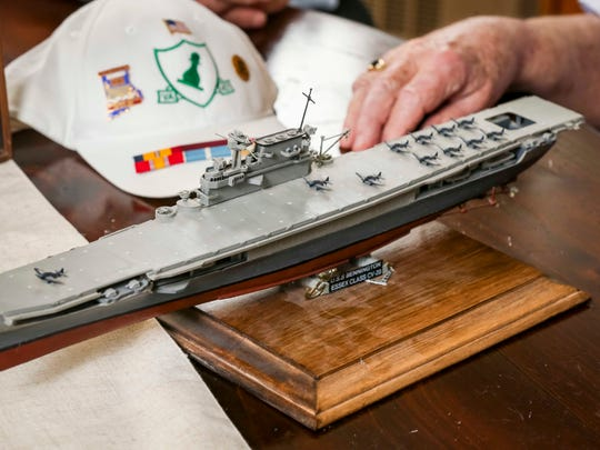"""Don Hauser and Albert """"Skip"""" Braak, with a model of the U.S.S. Bennington on  Thursday, June 28, 2018, in Des Moines."""