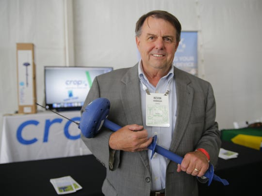Kevin Hannigan from CropX Technologies holding his company's soil moisture sensor.