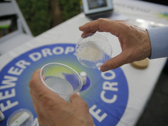 Dan Miller of mOasis shows his absorbent polymer to preserve water.