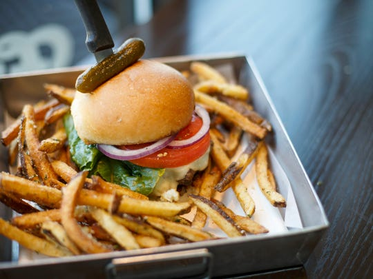 A turkey burger with a side of truffle fries at Frenchie Fresh in the Norwood neighborhood of Cincinnati on Friday, June 29, 2018.