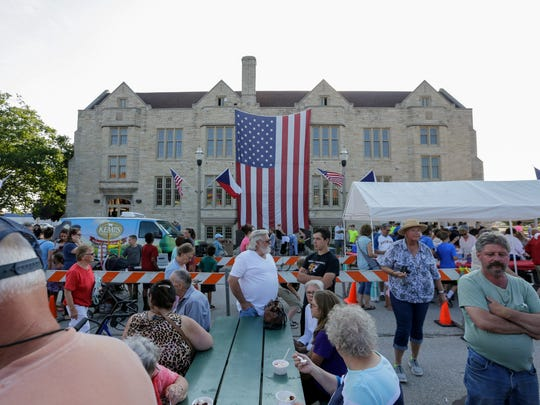 People gather outside the community house to celebrate the birthplace of the ice cream sundae during Sundae Thursday at Central Park Thursday, June 28, 2018, in Two Rivers, Wis. Josh Clark/USA TODAY NETWORK-Wisconsin