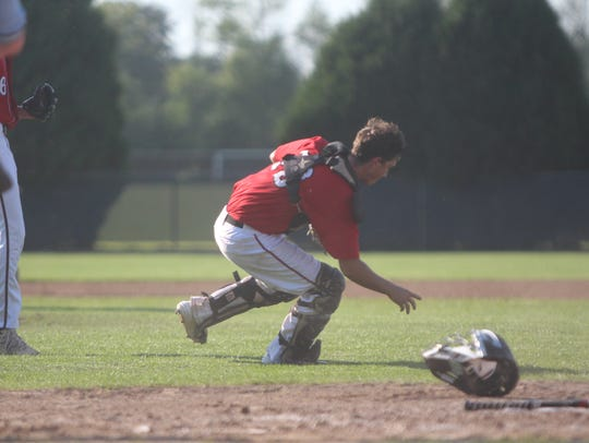 Sussex Hamilton catcher Matt Miller scrambles to pick