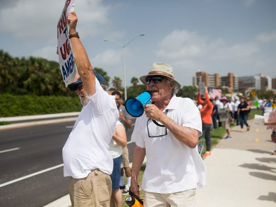 Arnold Gonzales chants through a megaphone and protest during the Keep Families Together Rally in Cole Park on Saturday, June 30, 2018, in Corpus Christi, Texas.
