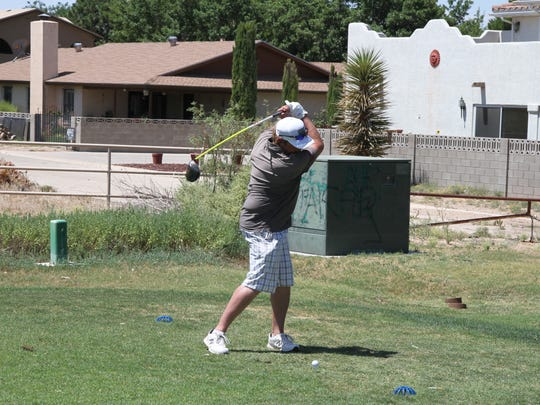 Mike Williams loads up to his ball on the 2nd hole during Saturday's Carlsbad Chamber of Commerce Golf Tournament.