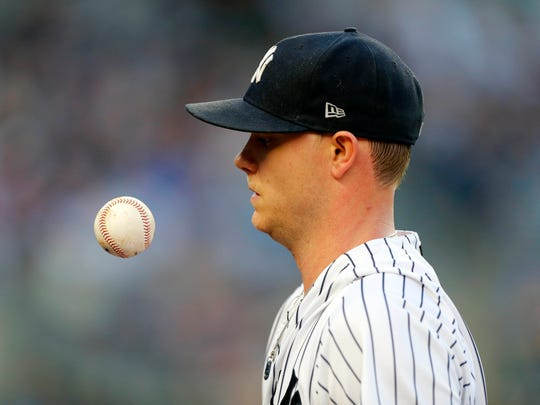 Jun 30, 2018; Bronx, NY, USA;  New York Yankees starting pitcher Sonny Gray (55) goes to the dugout in the second inning against the Boston Red Sox at Yankee Stadium.