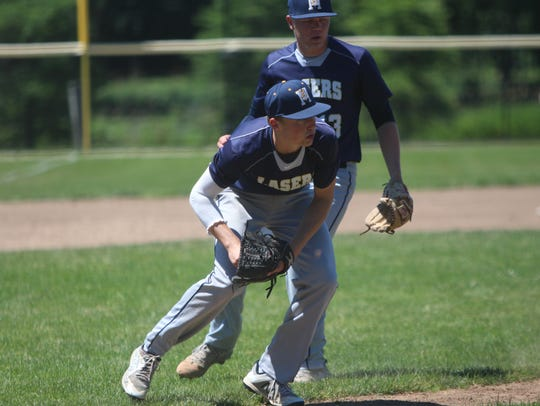 Kettle Moraine third baseman Max Herro fields a bunt
