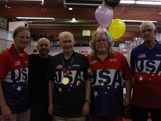 Richard Hicks, middle, with other table tennis players who competed at the 2018 World Veteran Championships.