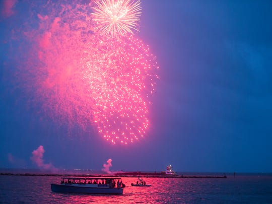 People enjoy the City of Corpus Christi Mayor's Big Bang Celebration firework show  on Wednesday , July 4, 2018 on Shoreline Boulevard.