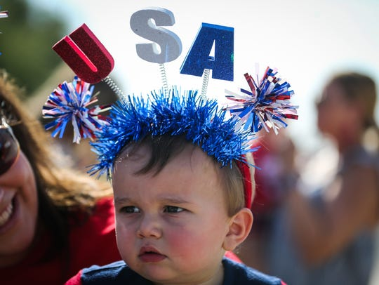 Levi Wankowski, 1, sports a patriotic headband for the Fourth of July parade Wednesday in Wall.