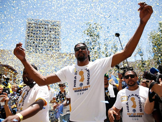 Kevin Durant interacts with fans during the Warriors'