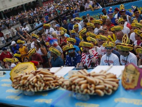 People attend the Nathan's Hot Dog Eating Contest.