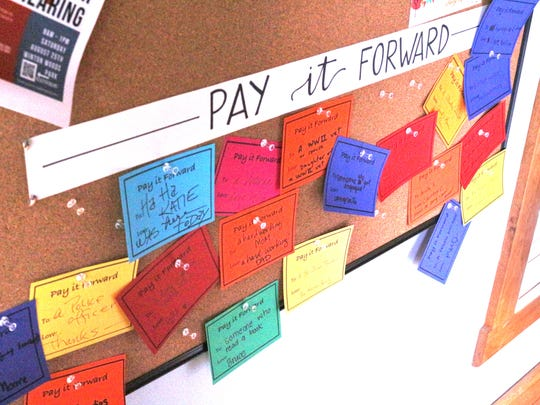 This Pay it Forward board lets customers buy a cup of coffee for a stranger.