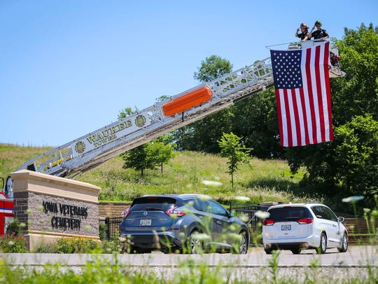 A procession from West Des Moines with the remains of three veterans arrive at Iowa Veterans Cemetery near Van Meter, Friday, July 6, 2018.
