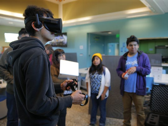 Salinas High Student Omar Hernadez trying out VR at Cesar Chavez Library.