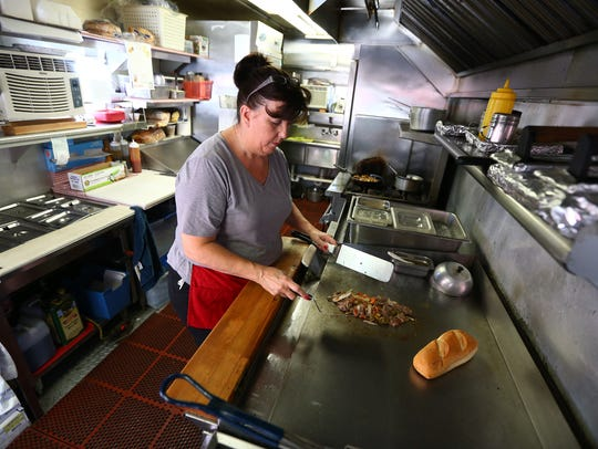 Mary Lombardo cooks up a Philly Cheesesteak at J&M