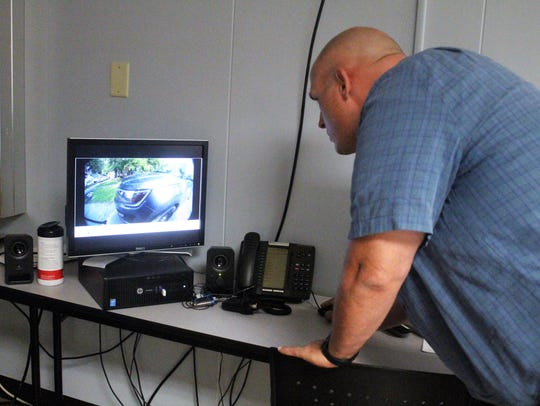 Marion Police Major Jon Shaffer reviews footage that
