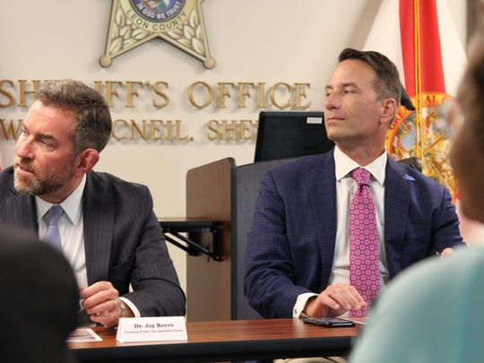Dr. Jay Reeve, left, the CEO of the Apalachee Center and Mike Watkins, the CEO of Big Bend Commnity Based Care listen during an opioids round table discussion with Florida Congressman Neal Dunn.