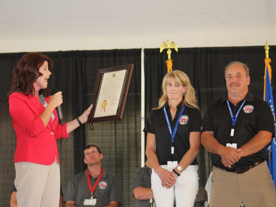 Lt. Governor Rebecca Kleefisch reads a proclamation from Governor Scott Walker during the opening ceremony on July 10 at Farm Technology Days.