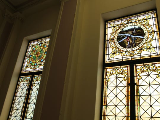 The city seal stained glass window will come down and be replaced by a mosaic medallion that is found on other stained glass windows throughout City Hall.