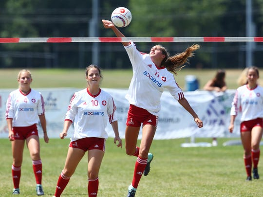 Switzerland's Lena Zellweger spikes the ball vs. Team