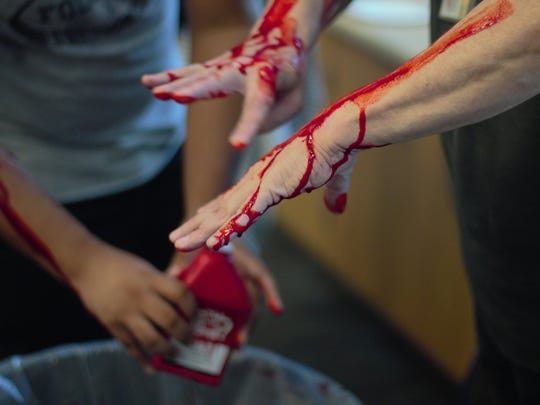 Before the drill, students and teachers were assembled inside the performing arts center for instructions. Those who volunteered to play victims, covered themselves in fake blood a - in some cases - theatrical make up mimicking bullet wounds.